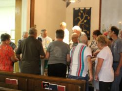 Congregation blessing the Blanket of Healing and Peace for Blas.